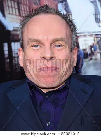 LOS ANGELES - APR 05:  Warwick Davis arrives to the Wizarding World of Harry Potter Opening  on April 05, 2016 in Hollywood, CA.