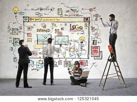 Creative team projecting a website