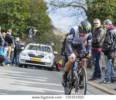 Conflans-Sainte-Honorine, France-March 6, 2016: The Australian cyclist Nathan Haas of Dimension Data Team riding during the prologue stage of Paris-Nice 2016.