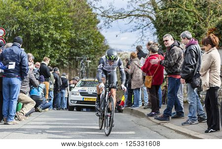 Conflans-Sainte-HonorineFrance-March 62016: The Australian cyclist Nathan Haas of Dimension Data Team riding during the prologue stage of Paris-Nice 2016.