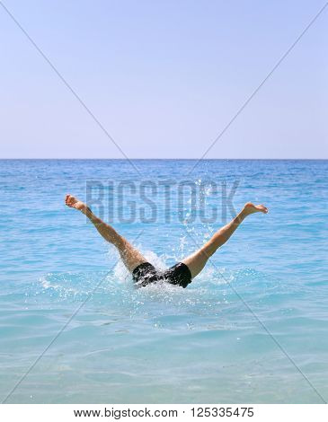 Funny summer holiday concept - legs of man swimming