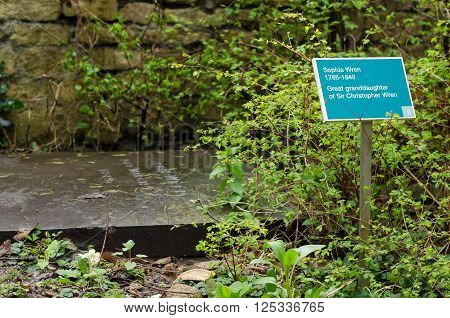 BATH, UK - APRIL 11 2016 Sophia Wren's gravestone. Sign indicating the gravestone of the great granddaughter of the celebrated British architect, in churchyard of Parish Church of Saint John Bathwick, in Bath, Somerset, UK