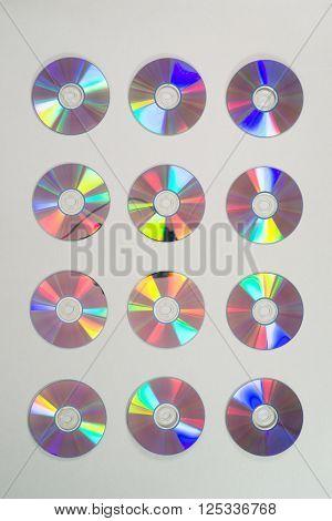 Twelve Compact Discs In Rows Of Three