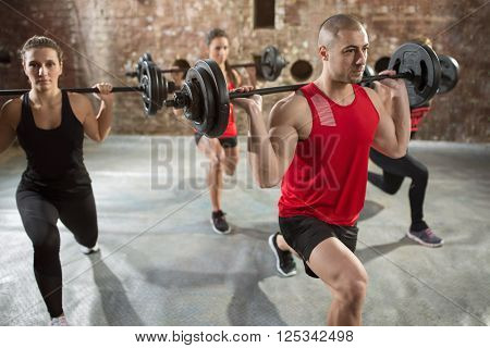group people well trained bodybuilder with dumbbells