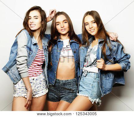 Fashion portrait of three stylish sexy  girls best friends,