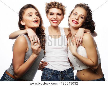 Fashion portrait of three stylish sexy girls best friends