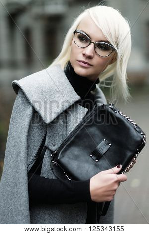 Autumn portrait of beautiful blonde woman