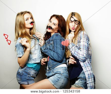 Stylish sexy hipster girls best friends ready for party.