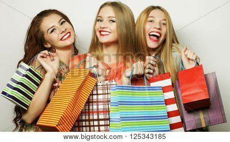 Beautiful young women with shopping bags