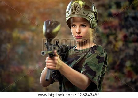 attractive female paintball targeting with gun