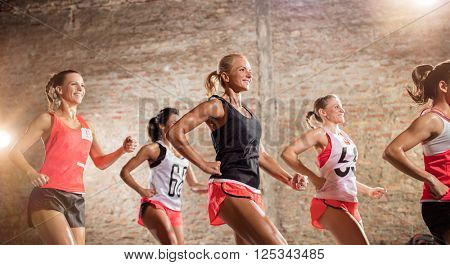 Group of young women smiling while doing exercise