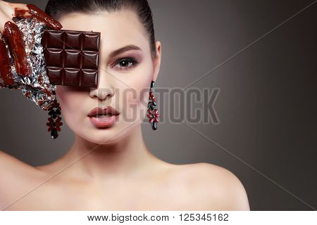 Beautiful sexual  girl with green eyes in a molten chocolate