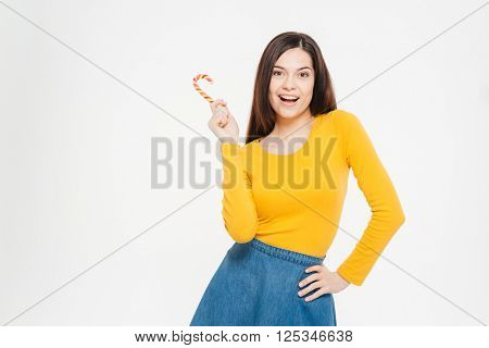 Cheerful woman holding lollipop isolated on a white background