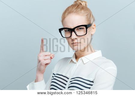 Woman wagging her finger isolated on a white background