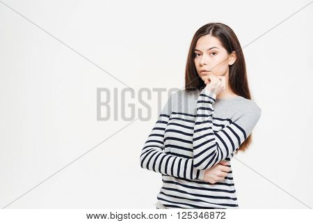 Young woman looking at camera isolated on a white background