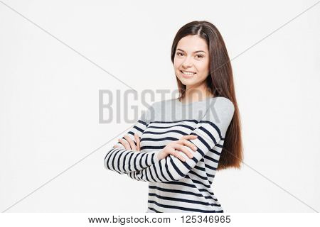 Smiling woman with arms folded looking at camera isolated on a white background