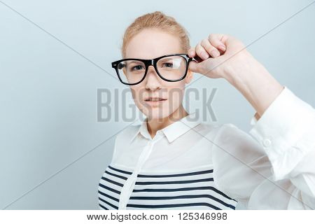 Casual woman in glasses looking at camera isolated on a white background