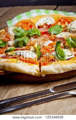 Italian pizza served on wooden table