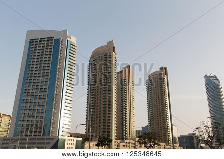 cityscape, travel, tourism and urban concept - Dubai city business district with skyscrapers