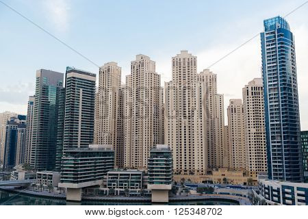 cityscape, travel, tourism and urban concept - Dubai city business district with skyscrapers and bridge
