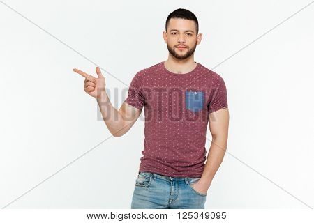 Casual man pointing finger away isolated on a white background