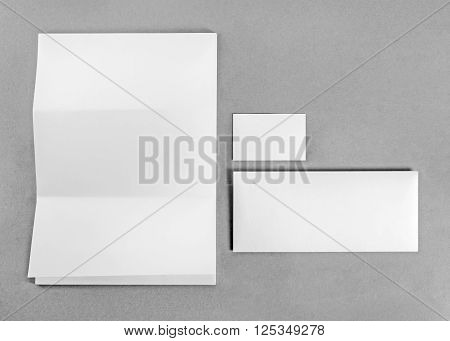 Blank stationery and corporate identity template on gray background. Mockup for branding identity. For design presentations and portfolios. Top view.