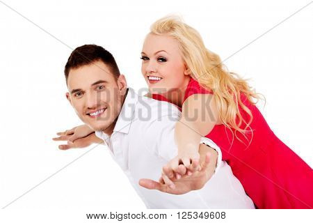Happy young couple  gesturing flying