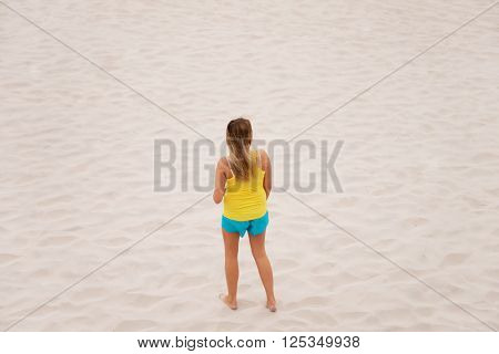 Tired woman standing on the beach