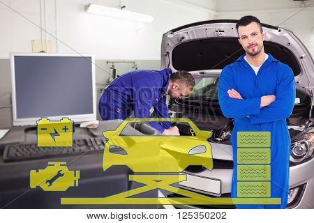 Mechanic standing arms crossed on white background against mechanic examining an engine of a car