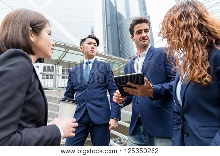 Group of business people chat at outdoor