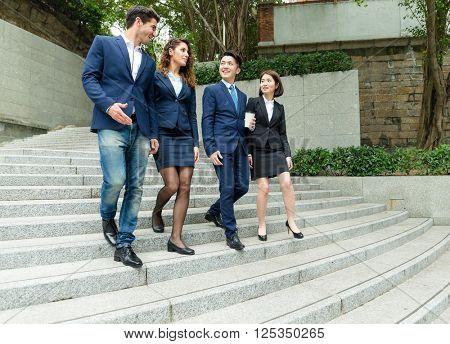 Business people walking at street