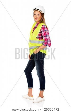 Young smile female builder in vest