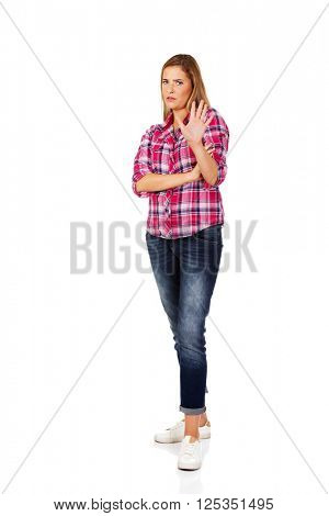 Resentful young woman gesturing stop sign