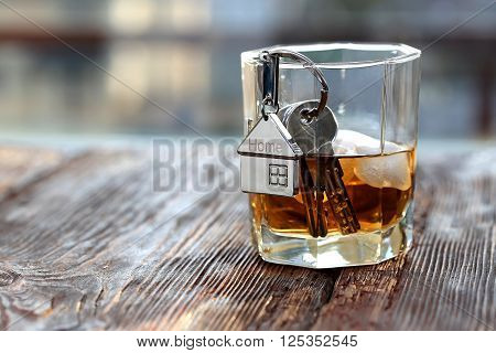 Keychain figure of house with keys and alcoholic drink