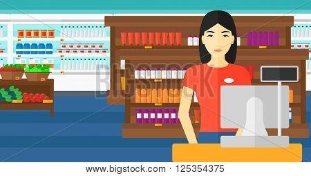 Saleslady standing at checkout.