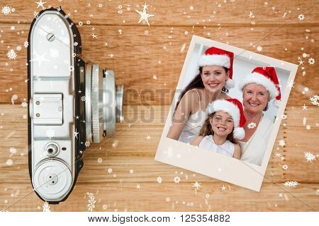 Daughter, mother and grandmother baking Christmas sweets against view of an old camera