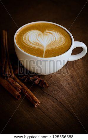 latte art coffee on wooden table, vintage coffee