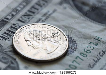 Quarter on US Dollar Bill Close up