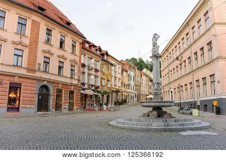 LJUBLJANA SLOVENIA - JULY 9 2009: Hercules fountain where Stari square and Gornji squares meet at the old town