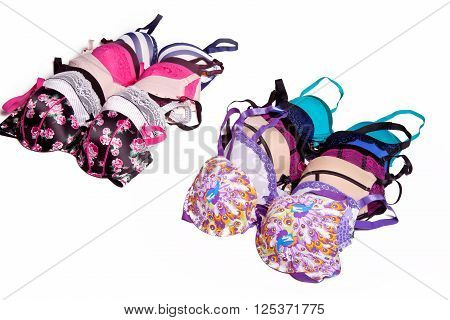 Many color women's bras in two rows on a white background