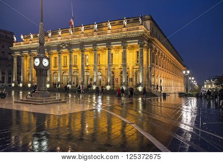 Bordeaux France - March 25 2016. People walking in front of Grand Theatre de Bordeaux at night. The theatre is home to the Opera National de Bordeaux and the Ballet National de Bordeaux. Bordeaux Aquitaine. France.