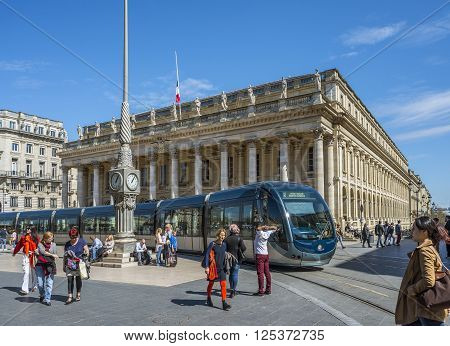Bordeaux France - March 26 2016. Tram rolling in front of Grand Theatre de Bordeaux at sunny day. The theatre is home to the Opera National de Bordeaux and the Ballet National de Bordeaux. Bordeaux Aquitaine. France.