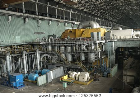 VARNA, BULGARIA, VARNA HEAT POWER PLANT, APRIL 12 2016: The machine hall of a Power plant Varna, Bulgaria. Gross power is 1320 MW, produced by six turbine-generators 220MW each; used fuel is COAL. The plant is decommissioned in 2015.