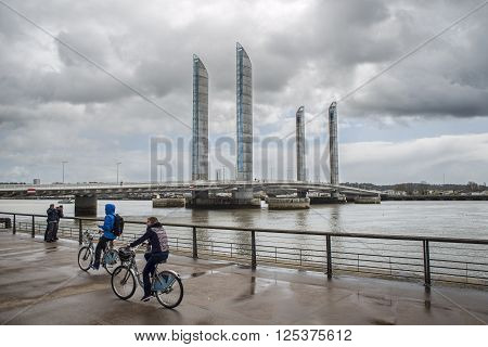 Bordeaux France - March 27 2016. People in bike rolling near to Pont Jacques Chaban-Delmas in Bordeaux. Aquitaine. France.