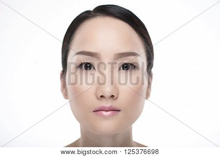 Flawless face of young beautiful Chinese woman