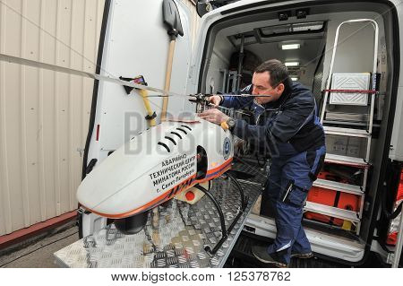 Saint-Petersburg Russia - April 6 2016: Preparation of an unmanned helicopter to a two-hour flight in the area of radiation accident radiation measurement photography and videography