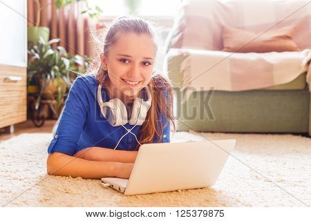Young Caucasian Teenage Girl Having Fun Use Laptop