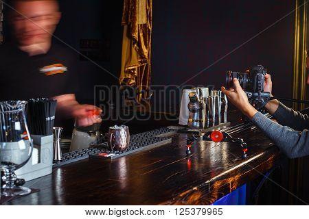 GRODNO BELARUS - NOV 7 2015: A film crew shoots a movie about work of bartender in gastrobar HOUDINI. Grodno Belarus November 7 2015