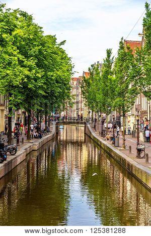Canal in De Wallen district of Amsterdam - Netherlands