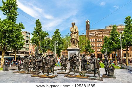 Amsterdam, Netherlands - June 9, 2014: Monument to Rembrandt and sculptures of his picture Night watch on Rembrandtplein Square.
